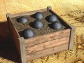 Wooden box with cannon balls