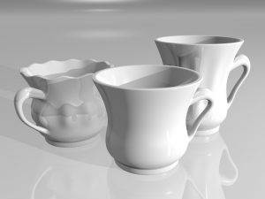 3 white porcelain tea cups on a gray background